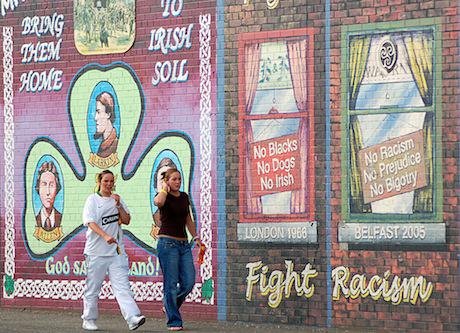 Girls in front of murals in belfast. Flickr-Anna %26 Michal. Some rights reserved